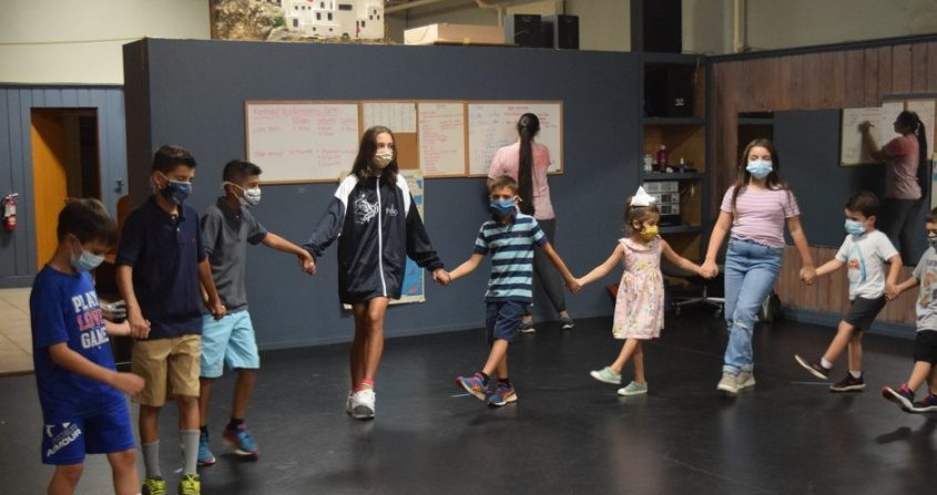 Children in St. George's Dance Troupe rehearse traditional Greek folk dances in preparation for this weekend's Greek Festival.