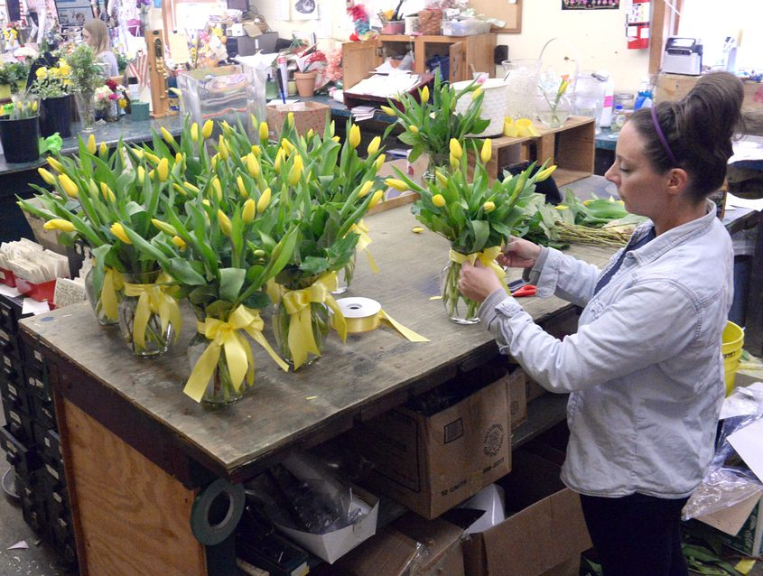 Floral designer Elesse Kennedy works in the shop at Felthousen's Florist and Greenhouse in Niskayuna in this 2018 file image.