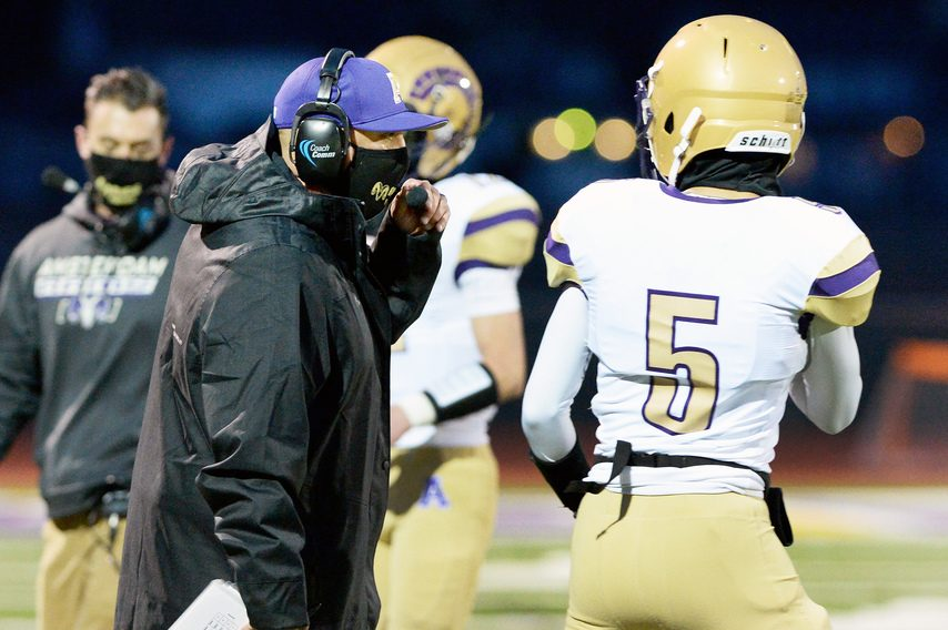 Amsterdam's head coach John Homich during their high school football game against Troy at Troy High School on Friday, March 26.