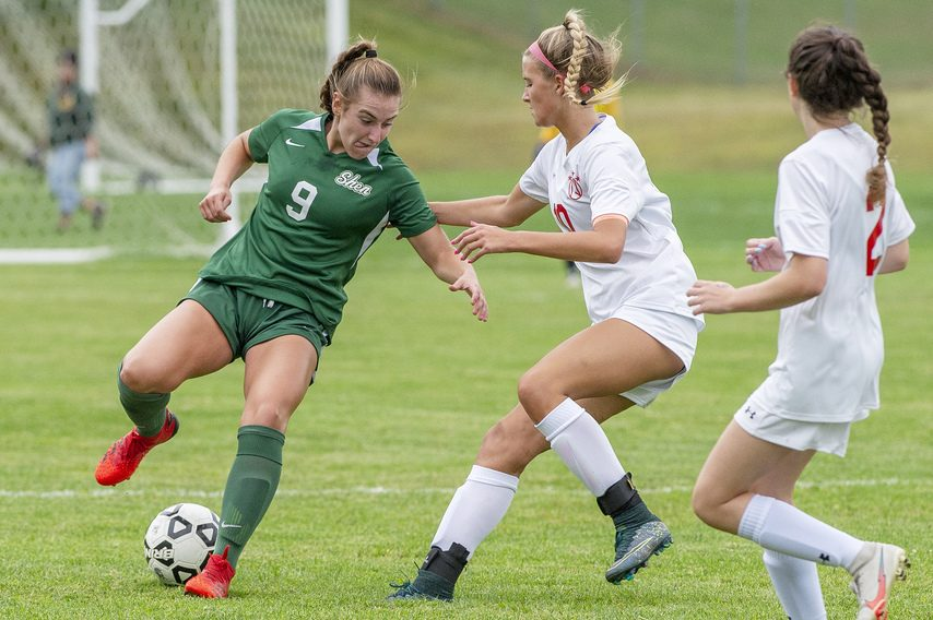 Shenendehowa's Mirabel Brunell with the ball against Niskayuna's Lauren Goyette during their high school soccer game at Shenendehowa in Clifton Park on Thursday.