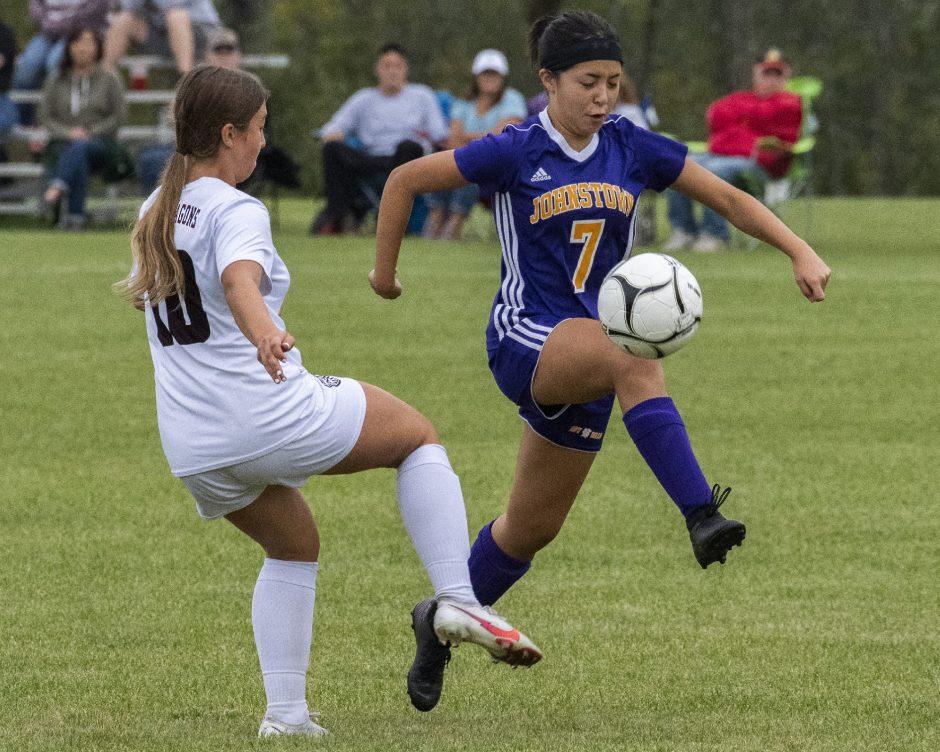 Johnstown's Kirsten Draper handles the ball next to Gloversville's Alex Albanese during Thursday's Foothills Council girls' soccer game.