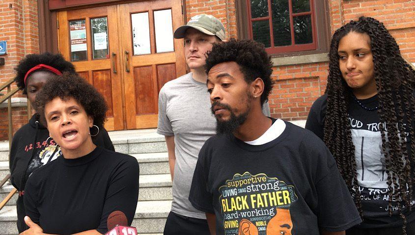 Jamaica Miles, front left, outside court Thursday.