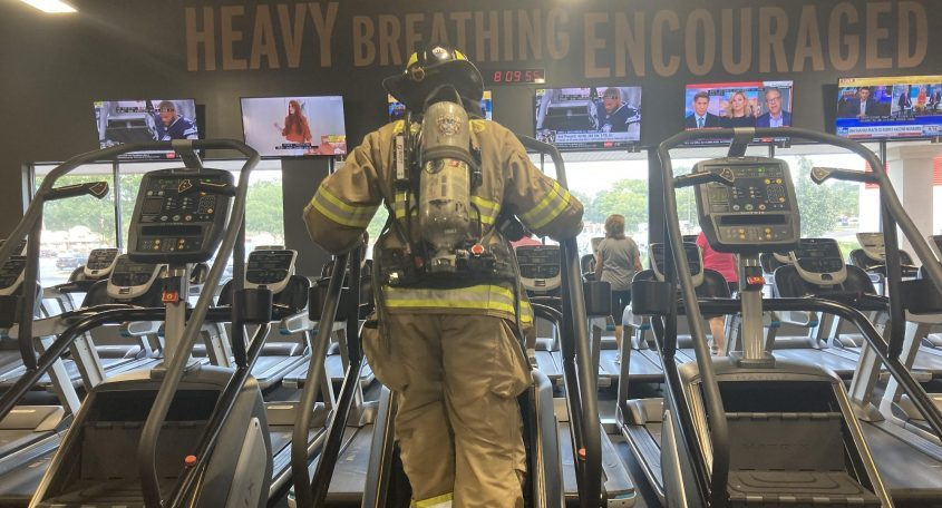 Gazette reporter Shenandoah Briere climbs the equivalent of 110 flights of stairs Friday at Crunch Fitness in Rotterdam.