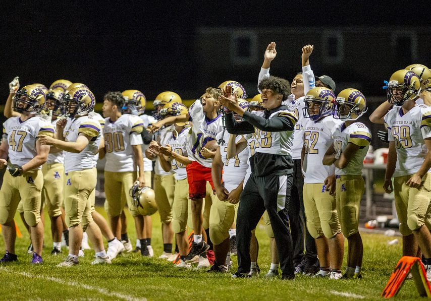 Amsterdam players cheer after scoring a touchdown during their high school football game at South Glens Falls High School on Friday, September 10, 2021.
