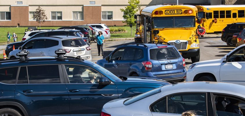 Parents pick up their children as a line of cars form in the pick up circle at Duanesburg Elementary School Friday.