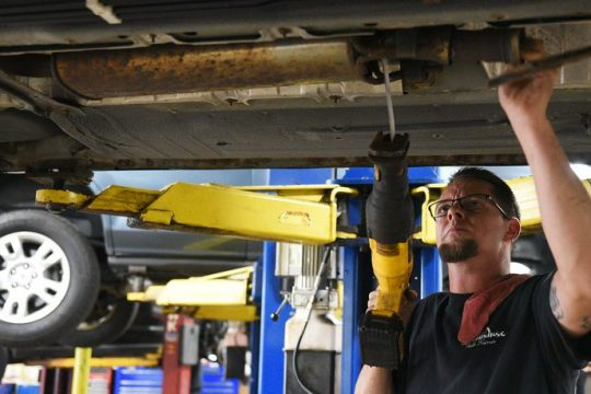 Caruso's Auto Repair mechanic Aaron Burton, of Cobleskill, works on a customer's exhaust in their busy garage on a busy afternoon Thursday, Sept. 9, 2021.