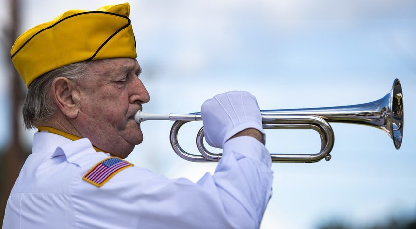 PETER R. BARBER/THE DAILY GAZETTE Norman Miller plays Taps at a 9/11 Ceremony at the Veterans of Foreign Wars Post 1895 in Rotterdam Saturday, September 11, 2021.