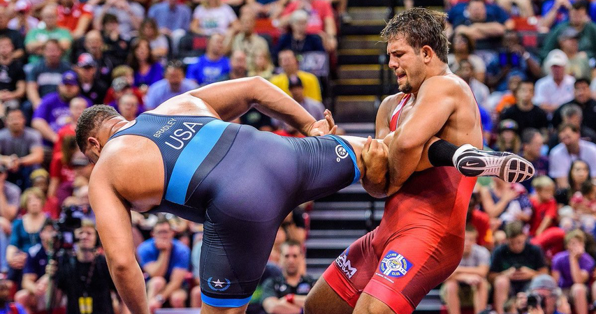 Heavyweight Nick Gwiazdowski, right, wrestles Dom Bradley during the semifinals of the U.S. Olympic Team Trials in Fort Worth, Texas, in April. (TONY ROTUNDO/WRESTLERS ARE WARRIORS)