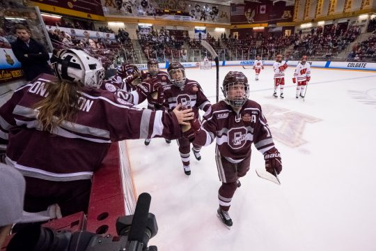 Breanne Wilson-Bennett leads the celebration line after scoring a goal against Wisconsin in the NCAA women's hockey Frozen Four on March 16, 2018, in Minneapolis. (Colgate Athletics photo)