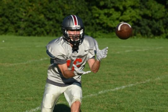 Silver Warriors receiver Brody Johnson looks a pass into his arms during a passing drill at Monday's Niskayuna football practice behind the high school. Sept. 13, 2021