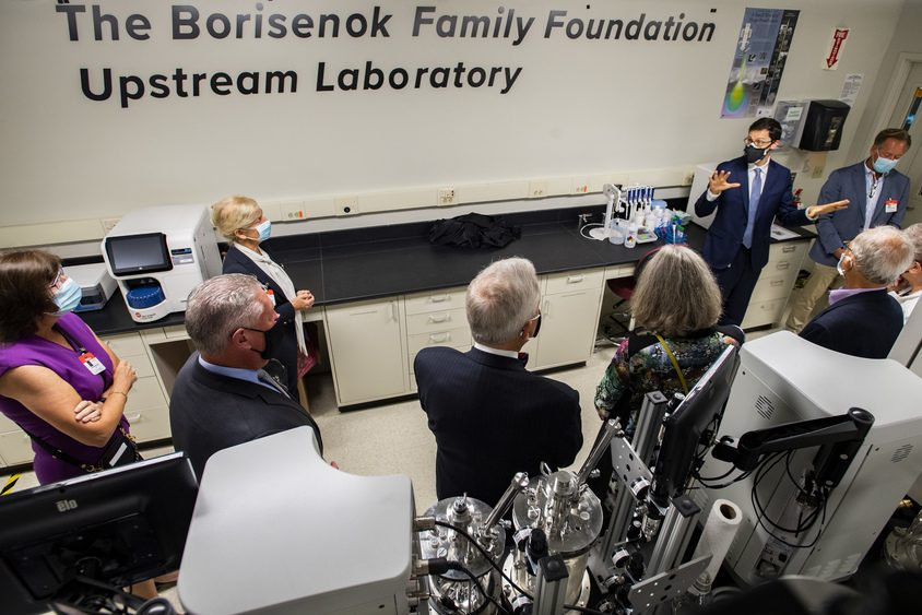 Dr. Julian Rosenberg, associate director the Stack Family Center for Biopharmaceutical Education and Training, right, gives a tour of the Borisenok Family Foundation Upstream Lab onTuesday.