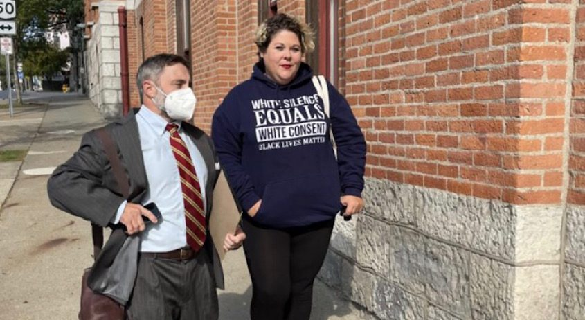 Colin Donnaruma, an attorney with the National Lawyers Guild, and Jessica Akyiano enter the Saratoga Springs police station on Tuesday so Akyiano could surrender on charges related to her participation in a July 14 protest in Saratoga Springs.