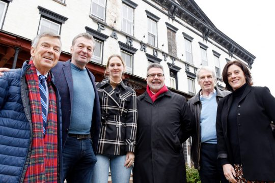 (L-R) SEEC Chair Tom Putnam, Parrott House owners Alex von Zehle and Nick Ahmetaj, Schoharie Mayor Larry Caza, SEEC Secretary Peter Johnson and SEEC Executive Director Julie Pacatte outside the Parrott House, on Main Street, in Village of Schoharie onin January 2020.The SEEC will now join the Parrott House on Main Street.
