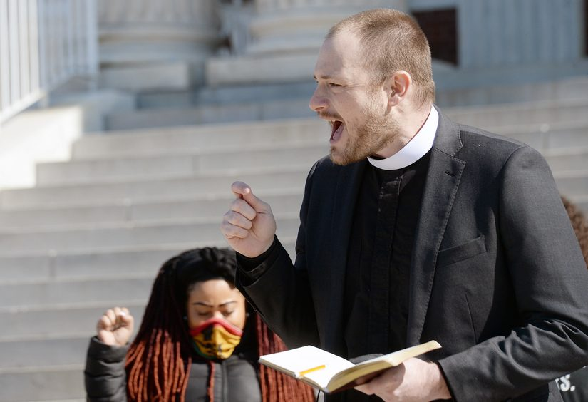 Messiah Lutheran Church Senior Pastor Rev. Dustin Wright speaks during a press conference at Schenectady City Hall as requests are made for changes to city hall meetings for voices to be heard during public hearings. Messiah Lutheran and SafeHaven LGBTQ+ Inc. are holding a music festival to raise money and awareness for Trinity Community Center, which will be housed at the former Trinity Reformed Church.