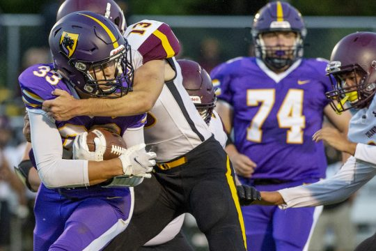 Ballston Spa's Blaine Zoller with the ball against Colonie's Jose D'Allessandri during their high school football game at Ballston Spa High School in Ballston Spa on Friday, Sept. 10.