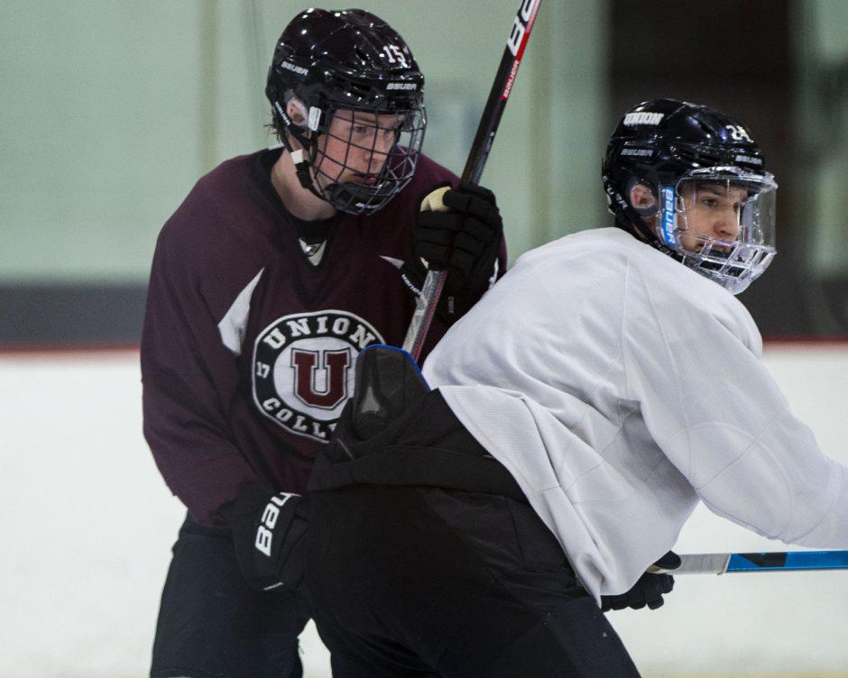 Union College hockey freshman forward Tom Richter, left, battles at practice Thursday at Messa Rink.