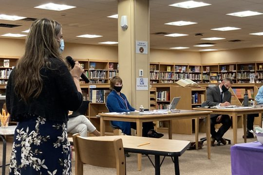 Parent Leslee Dominelli expresses concerns overschoolbusdelaysto the Amsterdam schoolboard on Wednesday.