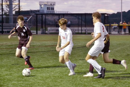 Broadalbin-Perth's Nick Bianco, center, controls the ball as Gloversville's Alex Rosmarino, left, defends during Thursday's Foothills Council South Division contest at Gloversville High School.