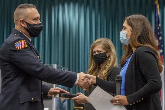 Niskayuna's newest Police Chief Jordan Kochan, with his wife Katrina by his side, shakes hands with Niskayuna Supervisor Yasmine A. Syed during his swearing in ceremonyat a special Town Board meeting at Niskayuna Town Hall Friday.