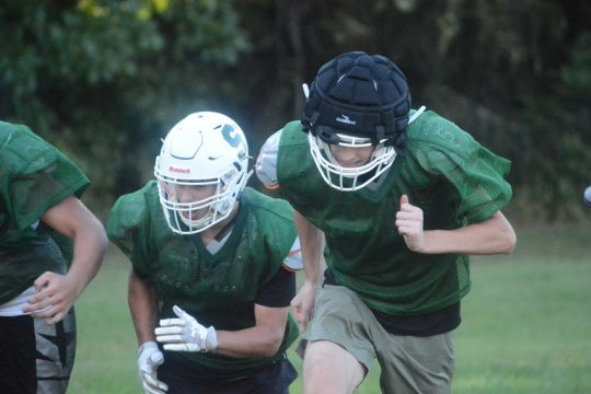 Schalmont football player Max Pratt, right, leads his team through sprints at the end of practice on Thursday, Sept. 16 at Schalmont High School.