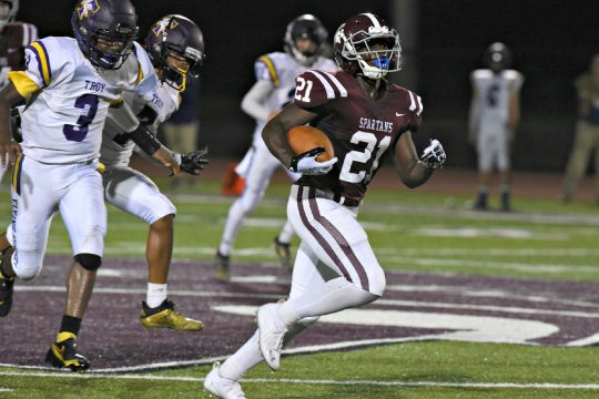 Burnt Hills-Ballston Lake running back Jaleel Joseph runs past the Troy defense on his way to a second-quarter touchdown Friday night in Section II Class A football action at Centennial Field at Burnt Hills-Ballston Lake High School.