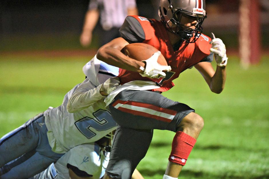Niskayuna's Dahvion Wimberly is tackled by Columbia's Tanner Malone after a catch in the third quarter during Friday's Section II Class A game at Niskayuna High School.