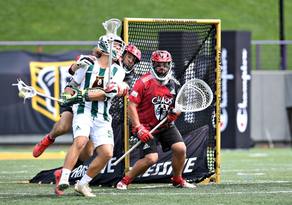Chaos goalie and University at Albany grad Blaze Riorden watches as Redwood attack Ryder Garnsey turns for a shot in the regular-season PLL finale played at Tom & Mary Casey Stadium at the University at Albany on Aug. 15.