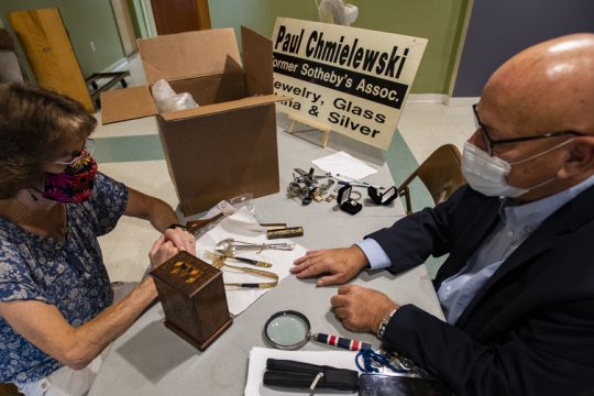 Elaine Schultz, left, has her antiques appraised by Paul Chmielewski at the Civic Players' Theater on S. Church Street in Schenectady Saturday.