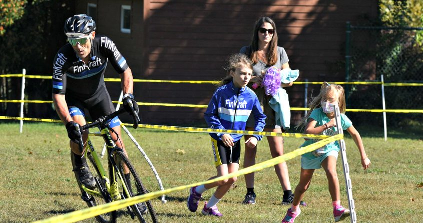 Lance Law is cheered on during the final lap of his race by Lily Law, 7, front and Arya Jakubowski, 9, of Niskayuna as Michelle Law looks on