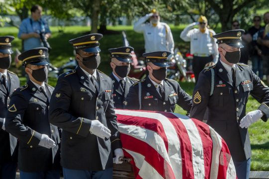 Members of Army National Guard Honor Guard carry the casket of Walter Smead for his committal service Monday.