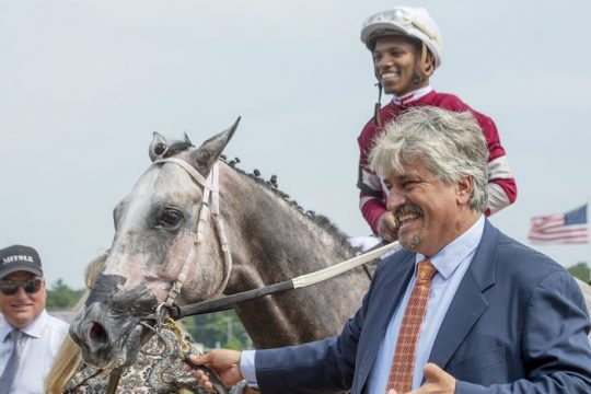 Trainer Steve Asmussen, shown with Whitney winner Knicks Go on Aug. 7, was ordered by the U.S. Department of Labor topay over $500,000 in back wages and penalties.