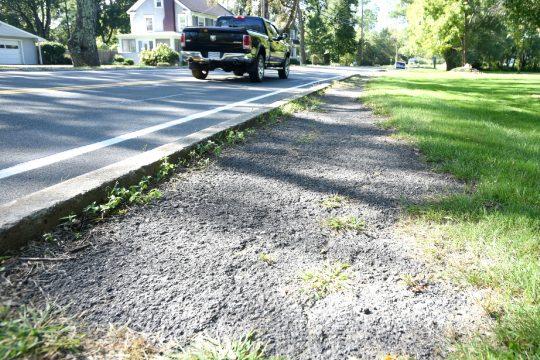 The sidewalk along Alplaus Avenue toward Maple Avenue in Glenvilleis deteriorated.