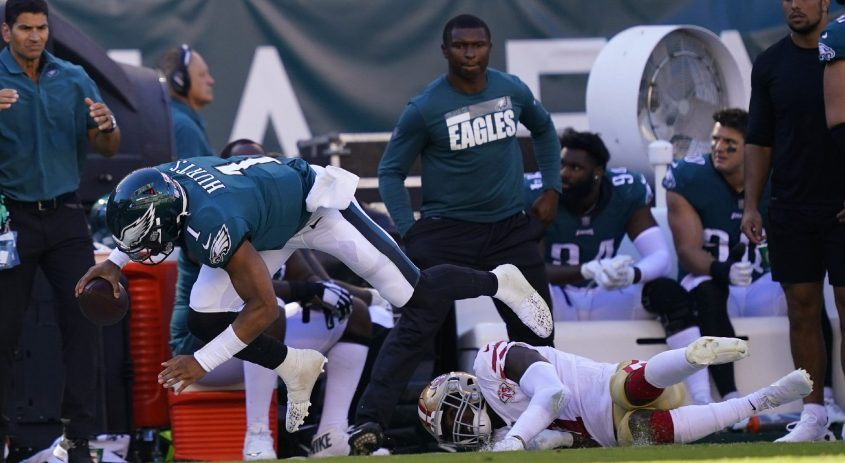 Philadelphia Eagles quarterback Jalen Hurts falls with the ball during the second half last Sunday's game against the San Francisco 49ers in Philadelphia. (Matt Rourke/The Associated Press)