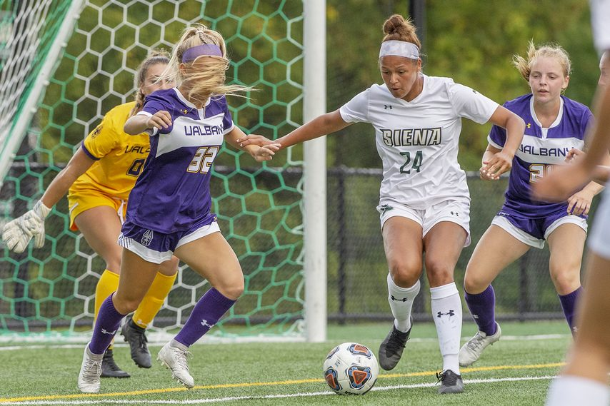 Siena's Jayanna Monds with the ball against UAlbany's Morgan Camarda, Amelia Smith and goalie Cassandra Coster during their soccer game at Siena in Loudonville on Wednesday, September 22, 2021.