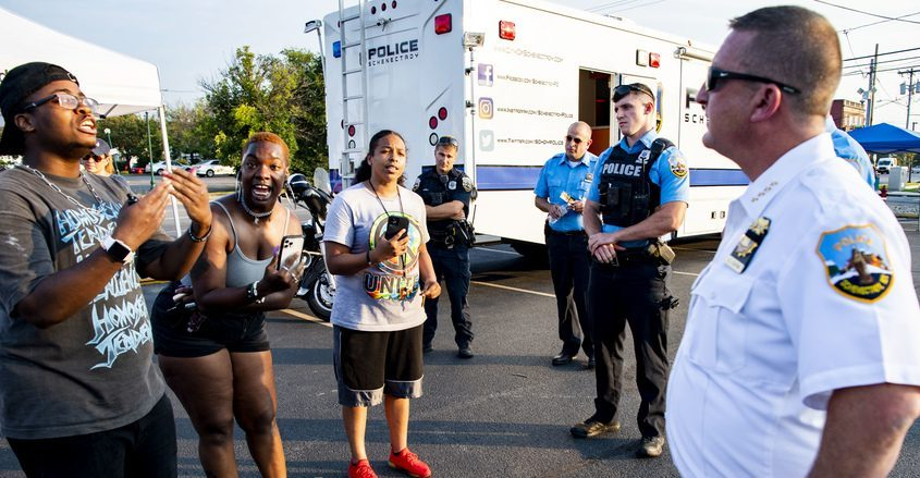 Activistsyell at Schenectady police chief Eric Clifford at a community outreach eventon Aug. 26.