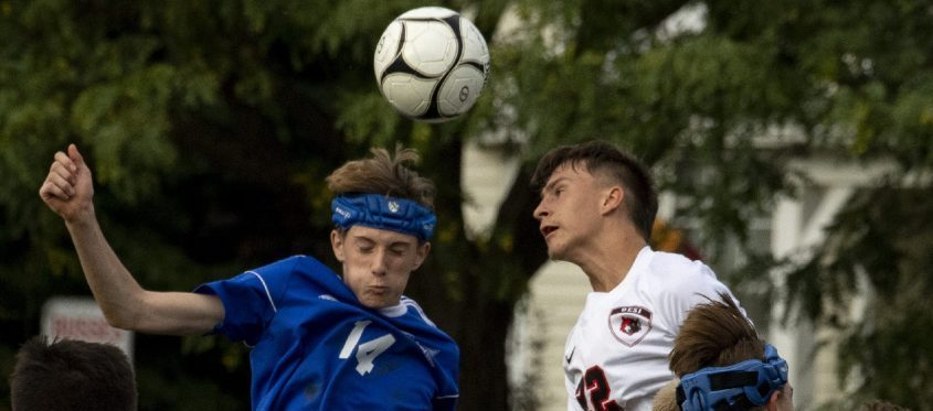 Northville's Landon Ginter, left, heads the ball with OESJ's Ian Smith on Wednesday, September 22, 2021.