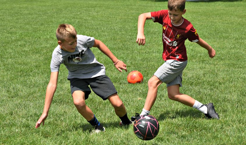 Brothers battle for possession of a soccer ball at Maalwyck Park in Glenville inAugust.