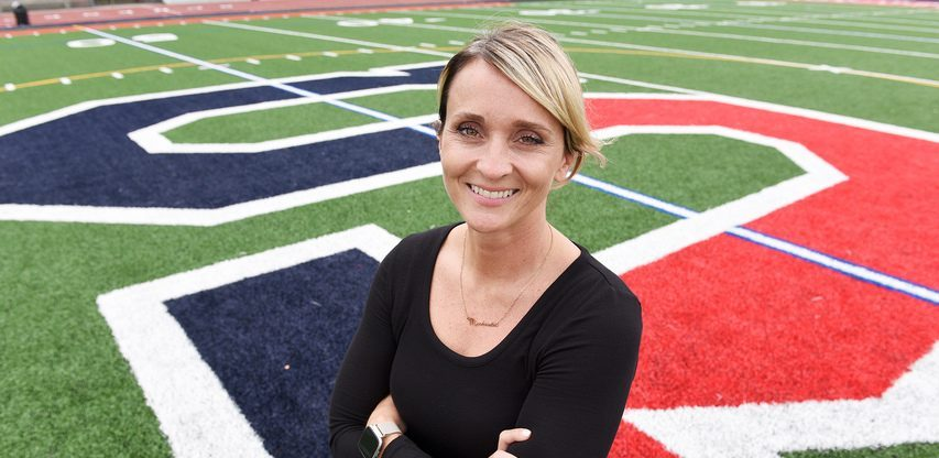 Schenectady athletic director Michaela McBride Miranda stands outside on the school's athletic field in Schenectady on Thursday, September 23, 2021.