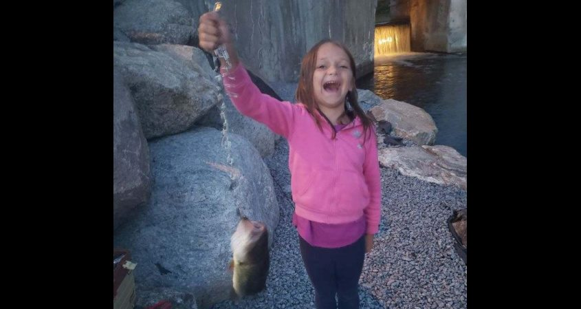 Madison Guidi of Schenectady shows off the 17-inch bass she caught recently while fishing with her father, Jason Guidi, in Brant Lake. (Photo provided)