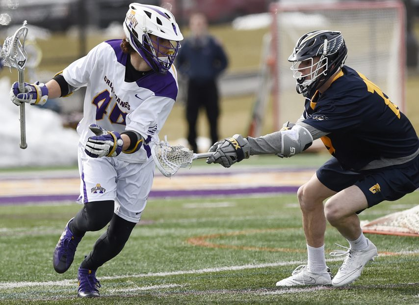 Former UAlbany men's lacrosse standout Kyle McClancy (left) has signed with the Albany FireWolves of the National Lacrosse League.