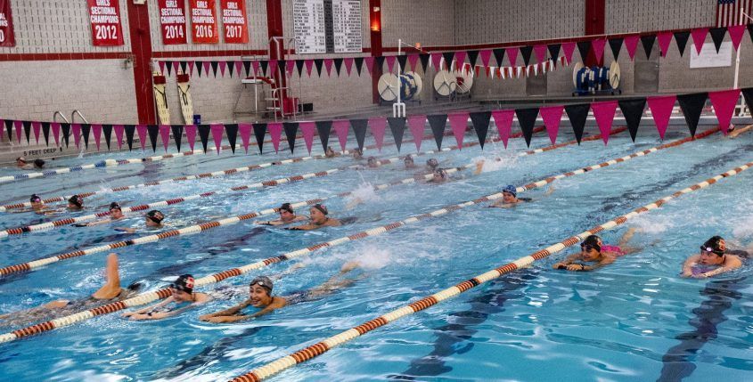 The Niskayuna High School girls swim team practices in the swimming pool Thursday. The school district is working toward reopening it to the public.