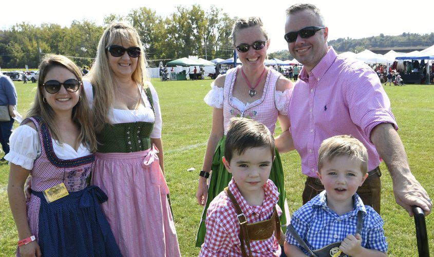 Dressed for the occasion at the 2019 Glenville Oktoberfest, clockwise from left, Claudine Murphy, her mother and a German language teacher Sabine Murphy, Julie and Kevin Scherer of Rexford, right, and their two sons Henry, 2, and Peter, 4 at the 10th Annualevent at Maalwyck Park.