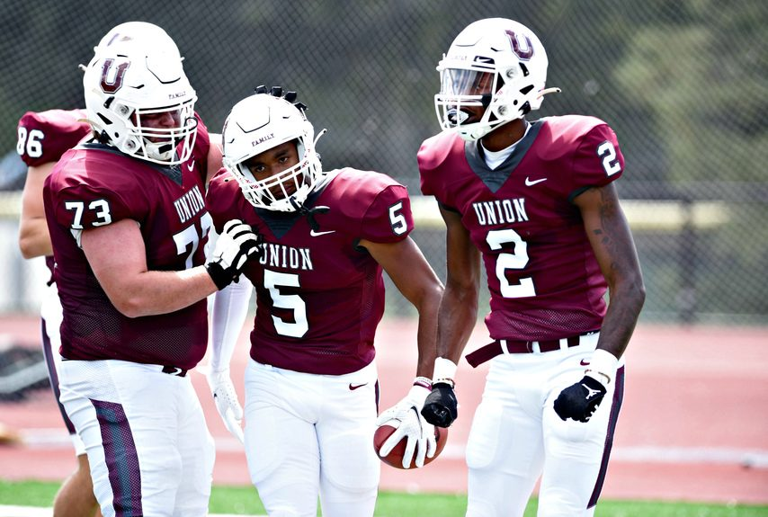 Union College wide receiver Robbie Tolbert is congratulated by lineman Kevin Dewing (73) and wide receiver Andre Ross Jr. (2) duringa Sept. 4 game at Frank Bailey Field in Schenectady.
