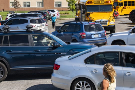 Parents pick up their children as a line of cars forms in the pick up circle at Duanesburg Elementary School on Sept. 10.
