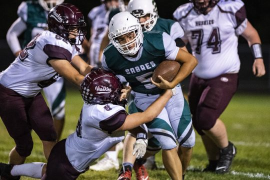 Schalmont quarterback Noah O'Connor is wrapped up by Gloversville's Kyle Robare during Friday's game.