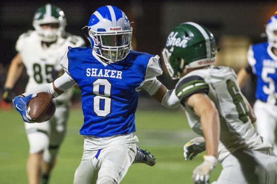 Shaker's Porter Ninstant with the ball against Shenendehowa's Gavin O'Connor during Friday's Section II Class AA football game at Shenendehowa.