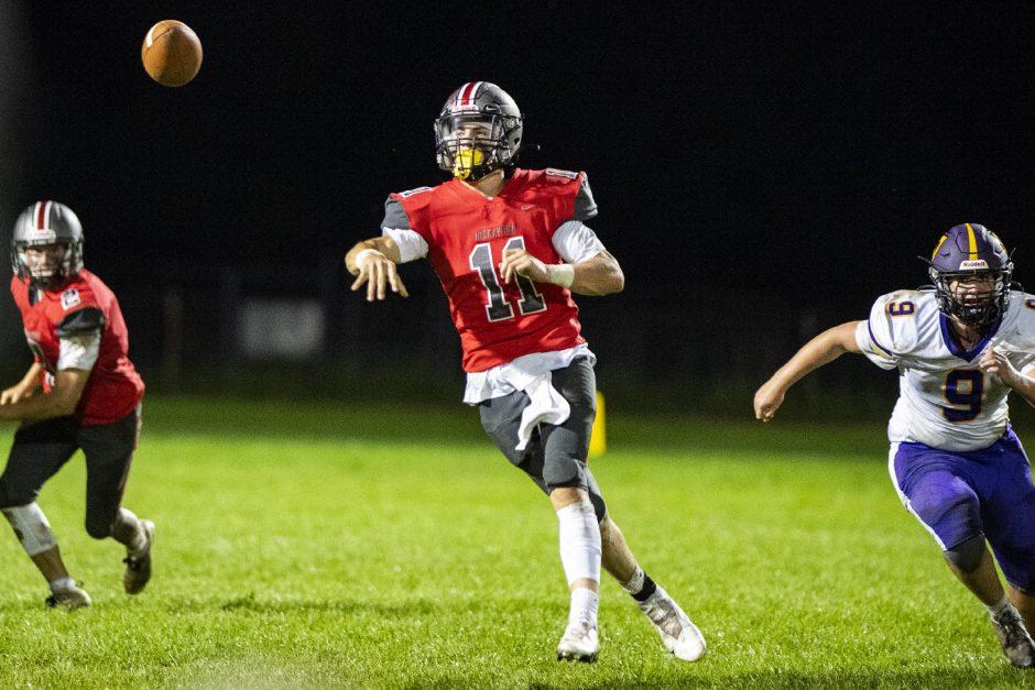 Niskayuna quarterback Dan Quinn makes a pass on the run between teammate Cole Nappi, left, and Ballston Spa's Landon Potter on Friday.