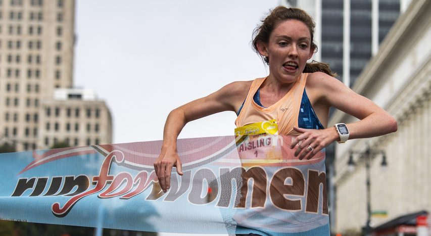 Aisling Cuffe breaks the tape to win the 43rd Freihofer's Run for Women 5k in 16:34 in Albany on Saturday.