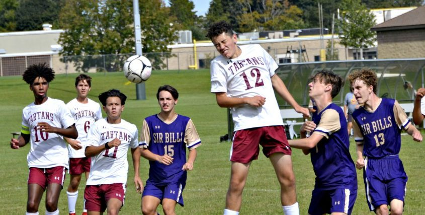 Scotia-Glenville's Sam Feinberg (12) heads the ball as Johnstown's Alex DeMagistris, right, defends during Saturday's Foothills Council boys' soccer game at Johnstown High School.