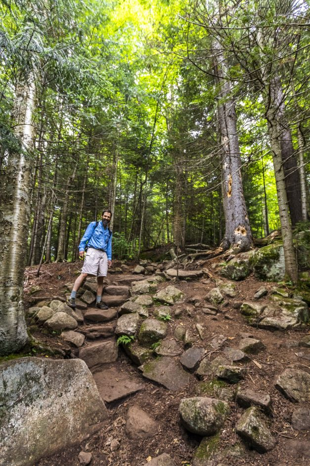 Adirondack Council Executive Director Willie Janeway poses at a recently improved section of the trail up Cascade.